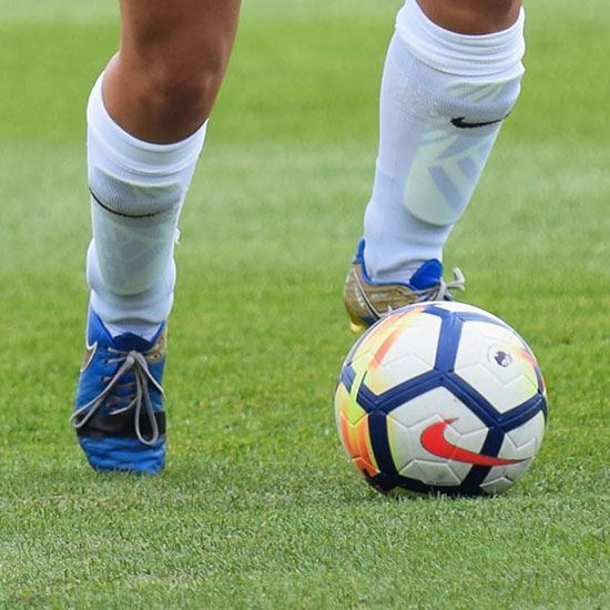 soccer players cleats with ball